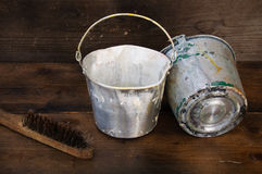 Paint cans or paint bucket on wooden background Royalty Free Stock Photography