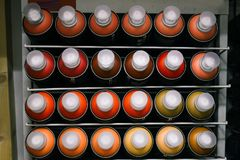 Paint cans are sold in the store. Showcase with cans of different colors with paint for drawing. Concept of creativity stock photos