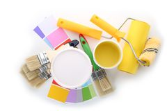 Paint cans and tools on white background stock images