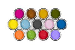 Paint cans on white background. An arrangement of 13 colourful paint tins on white background Stock Photography