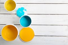 Paint cans on wooden table royalty free stock images