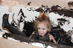 Paint and child in bathtub Royalty Free Stock Photos