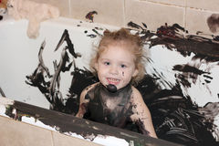 Paint and child in bathtub Royalty Free Stock Image