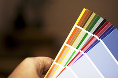 Paint chips. Hand holding colorful sample of paint chips stock photography