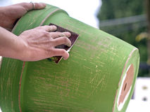 Paint clay pot and use sandpaper to decorate it. Paint clay pot and then use sandpaper to decorate it Stock Photography