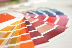 Paint color palette samples, closeup. House refurbishment royalty free stock photography