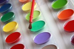 Paint colors with brush Royalty Free Stock Photo
