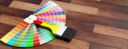 Colors catalogue and paint brush on wooden background. 3d illustration. Paint colors catalogue and brush on wooden background. 3d illustration Stock Photography
