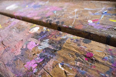 Paint daubs on arts and crafts table royalty free stock image