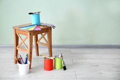 Paint and decorator`s tools. Near light wall stock image
