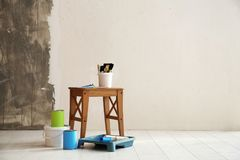 Paint and decorator`s tools. In light room stock image