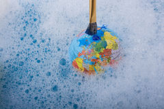 Paint dissolving on the top of globe Royalty Free Stock Photos