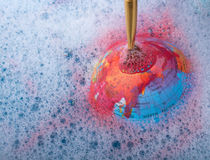 Paint dissolving on the top of globe Stock Photo