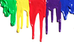 Paint dripping. Colorful paint dripping on white Royalty Free Stock Photo