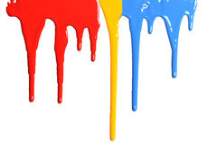 Paint Dripping in primary colors. Isolated on a white background Stock Images