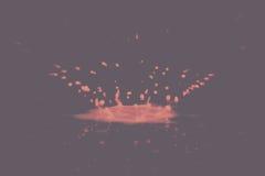 Paint drop splashing on black a background Vintage Retro Filter. stock photo