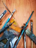Paint dry brushes of various sizes. On the floor stock images