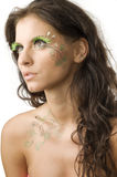 Paint and eyelashes. Nice and young woman with artificial eyelashes and leaves painted on her stock image