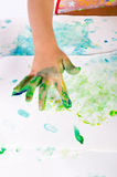 Paint with finger paints Stock Photography