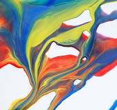 Paint flows. Mixed paint in differtent colors stock image