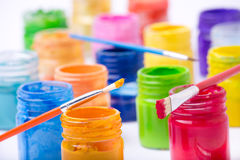 Paint in glass jars and brush Royalty Free Stock Photo