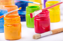 Paint in glass jars and brush Stock Photos