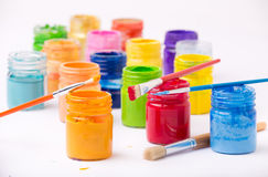 Paint in glass jars and brush Stock Image