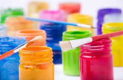 Paint in glass jars and brush Royalty Free Stock Photos