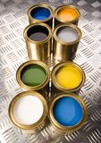 Paint and gold cans Stock Photography
