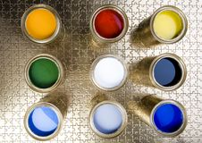 Paint and gold cans Royalty Free Stock Photo