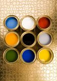 Paint and gold cans Royalty Free Stock Images