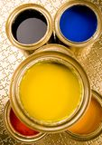 Paint and gold cans Royalty Free Stock Photos