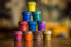 Paint. Gouache paint cans, colorful pyramid Stock Photography