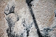 Paint, graffiti, gray dark colors on old antique Venetian walls Royalty Free Stock Photography