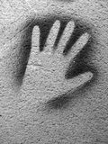 Paint hand on a wall. Hand trace on a wall stock images