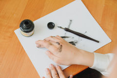 Paint hand writing chinese calligraphy Stock Photos