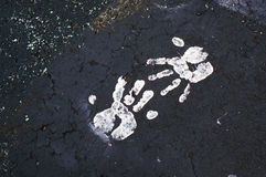 Paint Handprints on Pavement Stock Photos