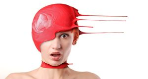 Paint on head. Splash of red paint on shocked woman's head Royalty Free Stock Photos