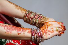 The paint henna on the hands down to your special day in Islam. stock images