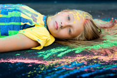 Paint Holi girl. Woman in nature paint sprinkled Holi summer royalty free stock photo