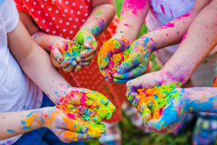 Paint holi on the hands stock photography