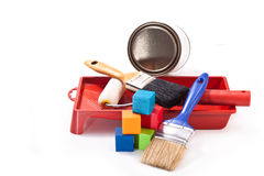Paint the house. Brushes for painting, roller, tray for paints, colored cubes on a white background Stock Photos
