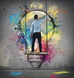 Paint an idea. Boy paints on wall a colorful idea Royalty Free Stock Photo