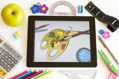 Paint on Ipad 3 and school accesories Royalty Free Stock Photo