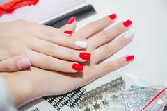 Paint lacquer red nails in beauty salon Stock Images