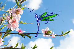 Paint made dragonfly flying around peach blossom Stock Photography