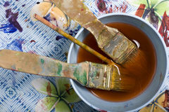 Paint Mess. With paintbrushes and mixing bowl Stock Images