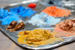 Paint Mixing. Mixing paint on aluminum foil Royalty Free Stock Photography