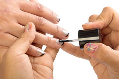Paint the nails Stock Images