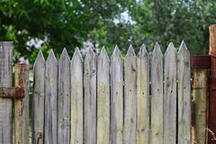 Old wooden picket gate with peeled paint stock photography